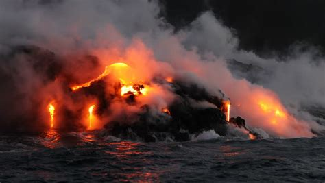 c big island lava boat tour lava flowing into the ocean from lava volcanic eruption on