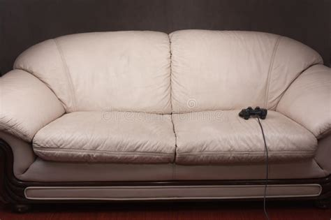 couch gaming empty couch with game controller stock photos image