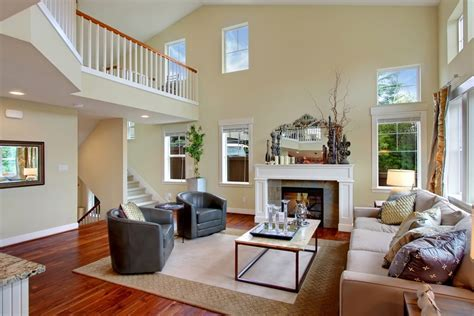 neutral paint colors for decorating family room with high ceilings and mirror above fireplace