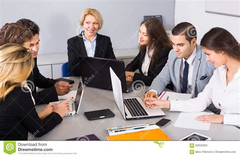 business team at meeting stock photo image 62842003