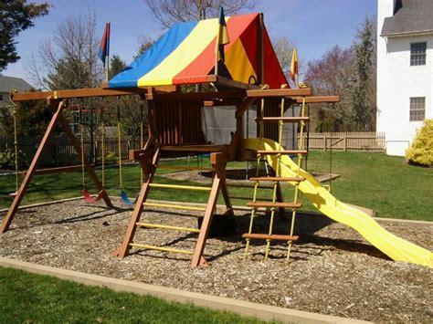rainbow swing sets costco rainbow play system restoration wood swing set around