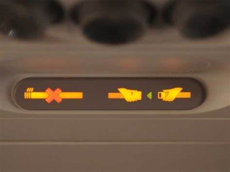 no smoking sign plane why you keep your seatbelt on in a plane business insider