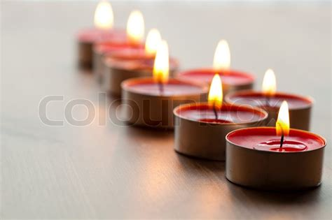 close up of red tea light candles for christmas stock