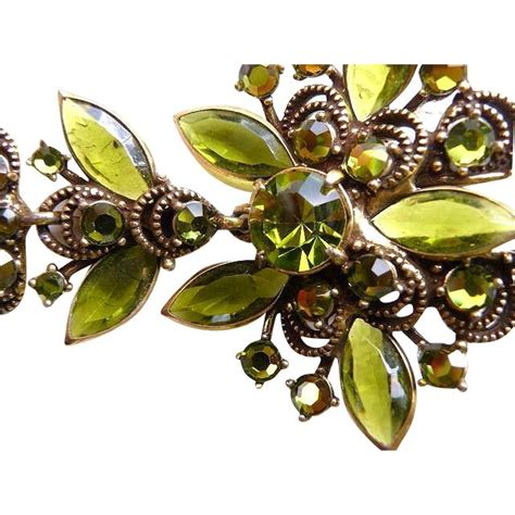 sapphire up with olives weiss olive green faux gold rs brooch set brooches