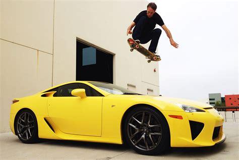 Fan Jumps Into Car by Lexus Fan Tony Hawk Uses Skateboard To Jump Lfa