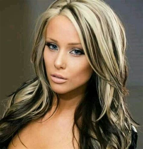 platinum blonde on the bottom and dark blonde om the top blonde hair with black highlights life is too short to