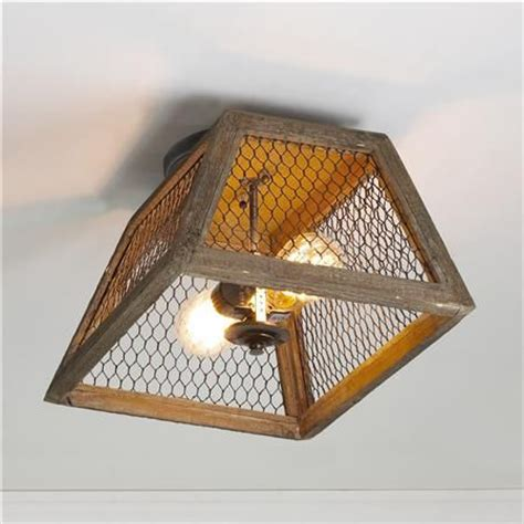 thrifted chicken wire light fixture bless er house
