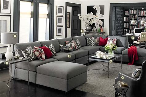 gray living room furniture light gray walls and dark floors dark brown hairs