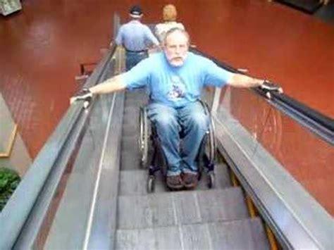going an escalator in a wheelchair