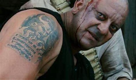tattoo on ajay devgan neck ajay devgn to angelina jolie stars religious tattoos