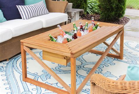 white outdoor coffee table with beverage cooler