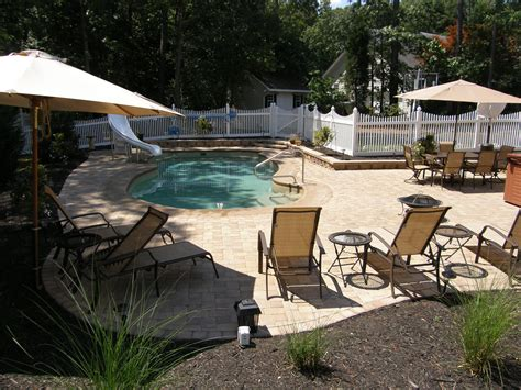 pool patio materials sted concrete vs pavers