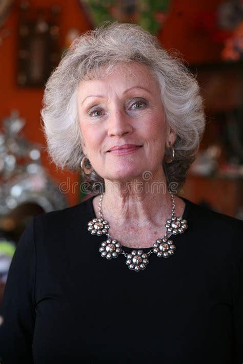 elegant mature woman wearing silver jewelry stock photo elegant mature woman wearing a silver necklace stock