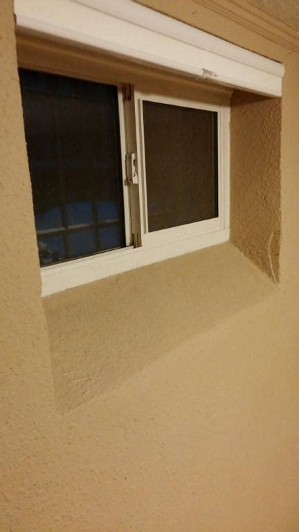 basement window bottom window sill is angled help