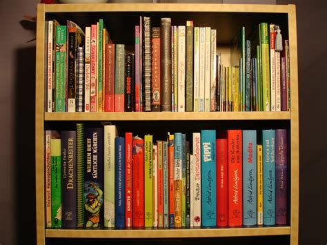 viewing photos of bookshelf showing 12 of 15 photos