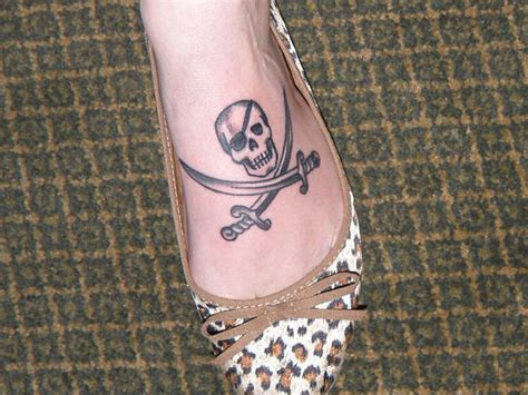 johnny depp jolly roger tattoo love this jolly roger tattoo on my ribcage of course