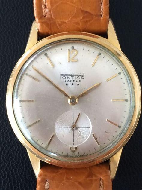 pontiac nageur horloge ca jaren  catawiki