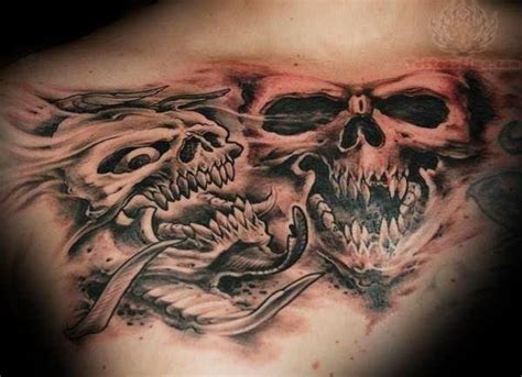 skull chest tattoos grey ink skulls on chest