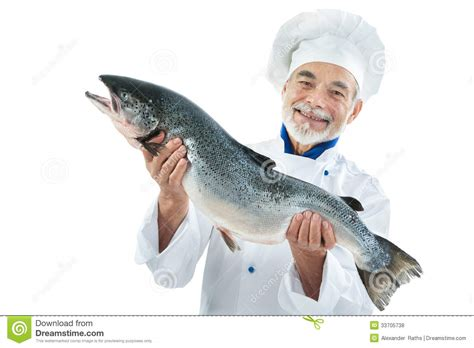cook with a big fish royalty free stock photos image