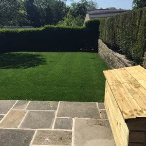 york paving with lawn area and railway sleeper steps