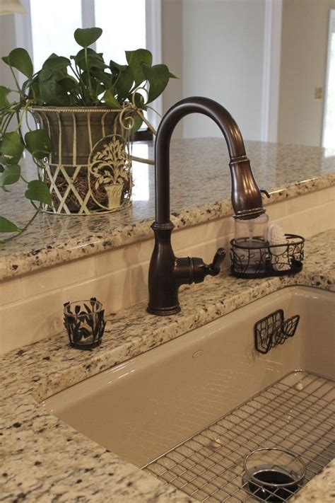 amazing kitchen faucet placement with white countertop 25 best ideas about bronze faucets on pinterest oil