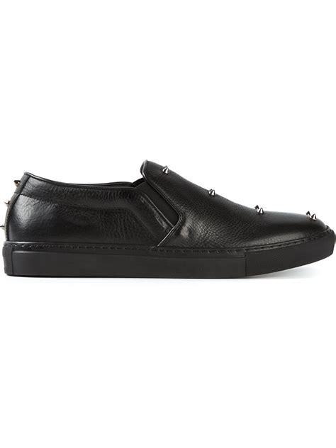 mcqueen mens sneakers mcqueen studded slip on sneakers in black for