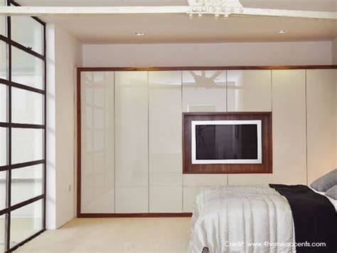 Bedroom Wardrobe Designs With Tv Unit by Smart Bedroom Wardrobe Design Ideas Luxus India