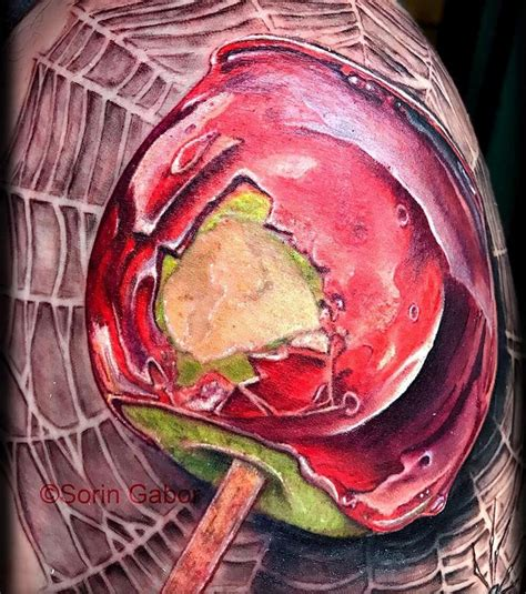 candy apple tattoo realistic color apple on spiderweb by sorin