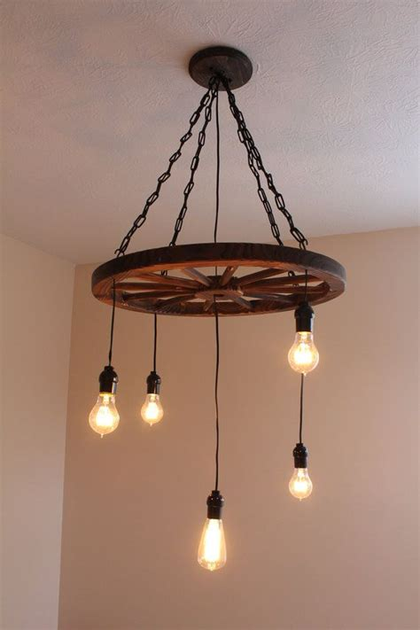 Diy Wagon Wheel Chandelier Best 25 Wheel Chandelier Ideas On Pinterest Wagon Wheel