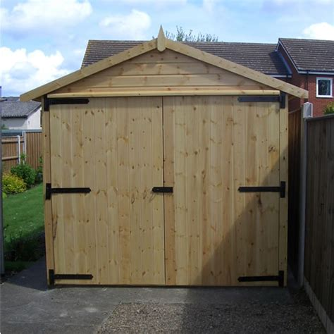 wooden garage with antique iron hinges