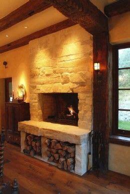 wood storage below fireplace home