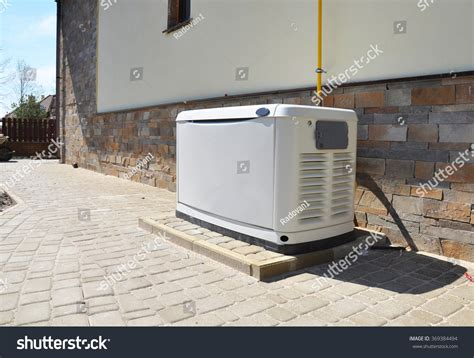big backup gas generator house stock photo