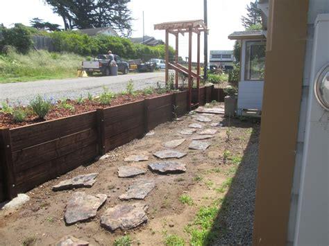 local fsc redwood pergola and retaining wall lush planet
