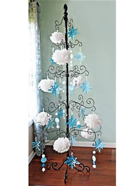 wrought iron tree displays your christmas ornaments