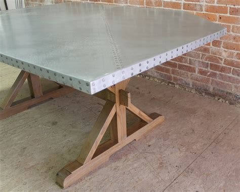angled zinc table for nook lake and mountain home