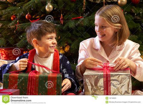 children opening christmas presents stock image image