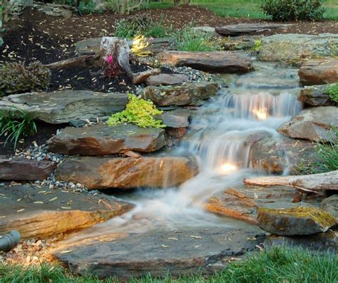 lighted natural pondless waterfall www personaltouchcolorado com landscaping ideas pinterest