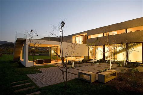 U Shaped House With Glass Lower Floor And Concrete Upper