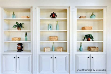 style your bookcases to stage your home organized by design