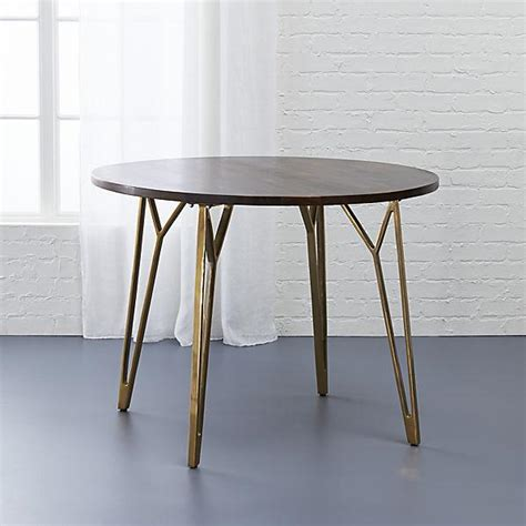 brown and brass dining table