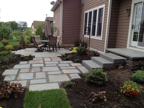 backyard stone patio backyard flagstone patio and gardens in maple grove