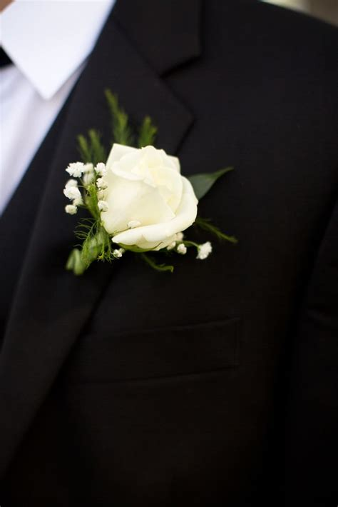 White Rose and Baby?s Breath Boutonniere
