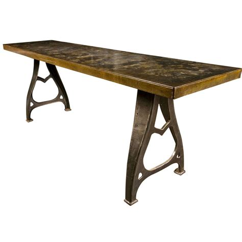 industrial work table with steel top and cast iron legs