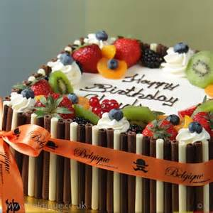 fresh fruit gateau celebration cake by belgique with mixed chocolate decoration available for
