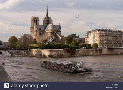 notre dame and bateau mouche on the river seine autumn in - Bateau Mouche Notre Dame