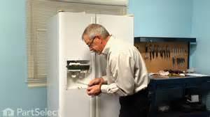 refrigerator repair replacing the water dispenser