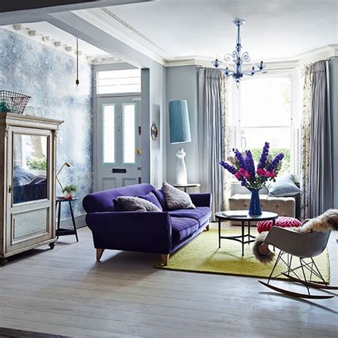 purple sofas living rooms eclectic living room with purple sofa decorating
