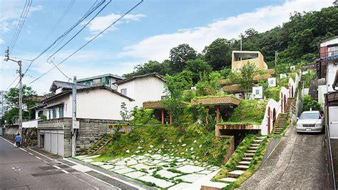 hobbit style apartment building rises  japan curbed