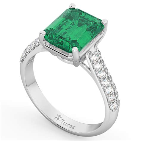 emerald cut emerald engagement ring 18k white