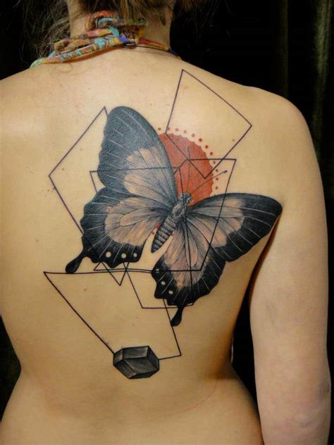 modern art tattoo artist xoil combines a butterfly with graphic